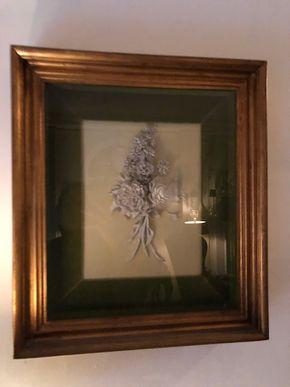 Lot 110 Framed Shadow Box of a white  Porcelain Floral Arrangement 20.5 H x 18W x 4D