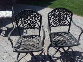 Lot 040 Pair Of Metal Swivel Patio Chairs 35.25H x 17.25W x 17.50L PICK UP IN N BALDWIN