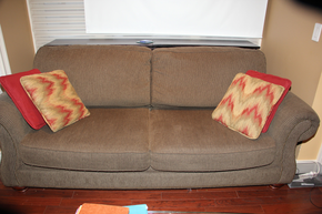 Lot 029 Upholstered 87 inch Long couch, Nail Head Detail includes 4 accent pillows ITEMS CAN BE PICKED  UP IN WESTBURY