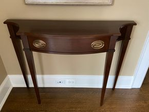 Lot 009 Dark Mahogany wood accent table 42in L X 12in W X 33in H PICK UP IN GARDEN CITY 1