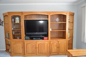 Lot 028 Oak Wood 5 Unit Entertainment Center 2 Corner Shelf Cabinets 75.5H x 26W x19.375W. 2 Glass Door Cabinets 75.5H x 27.875W x 19.375L. Center Cabinet 75.5H x 42W x 23L PICK UP IN SEAFORD, NY