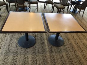 Lot 002  (2) 36 INCH square table tops, Solidz laminate top, with walnut finished eased edge and a round black metal table base -Bases are slightly worn PICK UP IN ROSLYN
