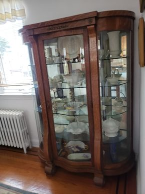 Lot 032 CC-Delivery either Peter or Another Service/Oak and Beveled Glass Curio Cabinet 4 Glass Shelf  63.375H x 45.5W x 14D CONTENTS NOT INCLUDED PICK UP IN WHITESTONE, NY