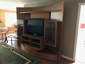 Lot 039 Italian Wood Entertainment Center With Three Drawers And Two Glass Cabinets. AS IS Chips/Scratches. 86H X 33W X104L. PICK UP IN ROCKVILLE CENTRE.