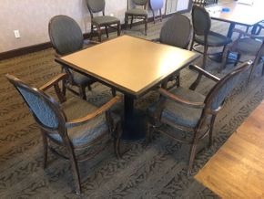 Lot 034 36 INCH  square table top, Solidz laminate top, with walnut finished eased edge and a round black metal table base -(4) wood arm chairs in walnut finish - fabric on chairs �?? Angelica in Cafe Brown -Indent on the wooden edge of the table PICK UPIN ROSLYN