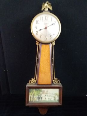 Lot 014 Sessions Banjo Clock 22in H x 7inL