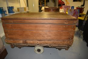 Lot 030 Restoration Hardware Vintage Wood Trunk on Wheels 21.5H x 23.75 W x 23.75D PICK UP IN PORT WASHINGTON,NY