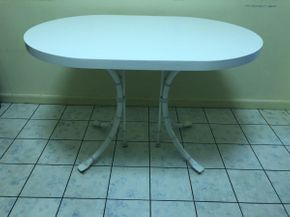Lot 079 Oval Corian / Formica Table 30 H X 30 W X 44 L. PICK UP IN FLUSHING.