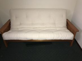 Lot 037 White upholstered Futon ITEM CAN BE PICKED UP IN ROCKVILLE CENTRE