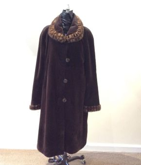 Lot 035 Dark Brown Sheared Mink w/Long Hair Mink Trim Reversible w/ Animal Print Pattern Size 12 Length 42 inches Sleeve 31 inches Sweep 66 inches Style 3346