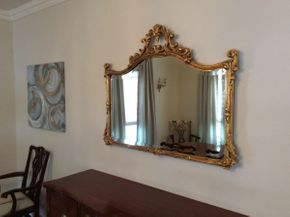 Lot 050 Antique Gilded Carved Mirror 42Wx 34.5H  ITEMS CAN BE PICKED UP IN GARDEN CITY