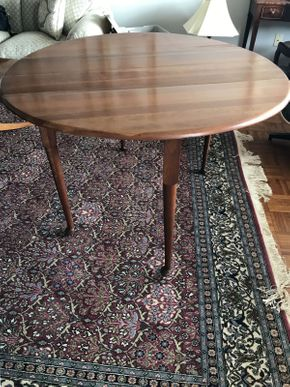Lot 061 Gate Legged Table with 3 Leaves and Case ITEM CAN BE PICKED UP IN GARDEN CITY