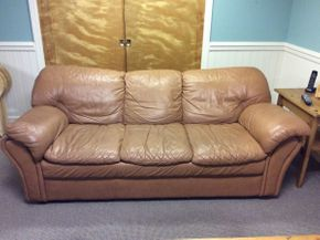 Lot 066 Leather Couch 81L x 31D x 32H  ITEMS CAN BE PICKED UP IN GARDEN CITY