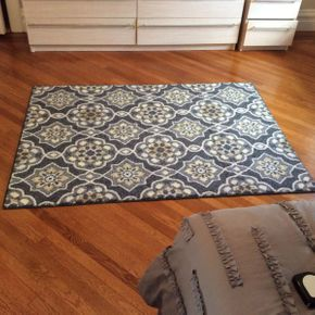 Lot 075 Decorative Area Rug 56.5 x 50  ITEMS TO BE PICKED UP IN GARDEN CITY