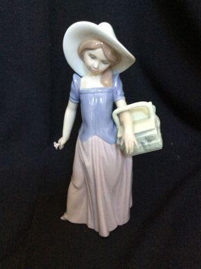 Lot 143 Lladro 1997 Event Figurine Girl with Basket 9inhx4inw  ITEMS TO BE PICKED UP IN MANHASSET HILLS