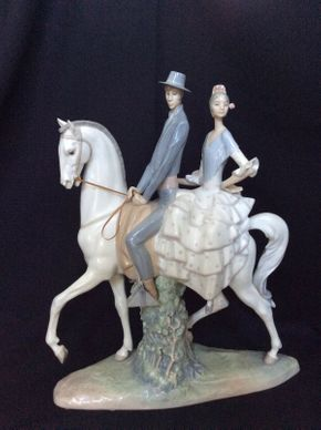 Lot 134 Lladro Man and Woman on a Horse 15wx18h  ITEMS TO BE PICKED UP IN MANHASSET HILLS