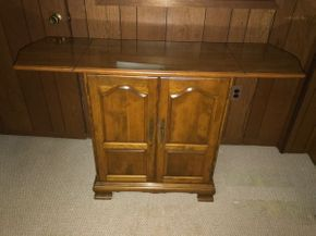 Lot 006 Ethan Allen Wood Flip Top Bar Liquor Cabinet AS IS. 34H X 17 W X 53.5L with flip top up - 30.75L when flip top down. PICK UP IN LAKE GROVE.