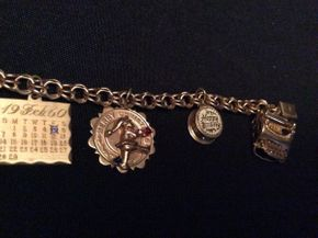 Lot 051 14K Gold Charm Bracelet Approx 20 DWT 7.5in Long ITEMS TO BE PICKED UP IN GARDEN CITY