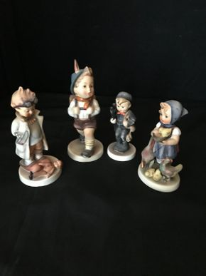 Lot 016 Lot of Four Hummel Figurines. School Boy With Backpack 6 Inches Tall. Boy With Ladder Chimney Sweep 3.75 Inches Tall. Girl Feeding Time Chicken 4.75 Inches Tall. Doctor Boy With Googles and Doll 5 Inches Tall. PICK UP IN LAKE GROVE.