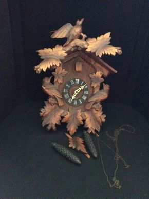 Lot 023 Hand Carved Wood Cuckoo Clock With Birds and Weights ITEM CAN BE PICKED UP IN GARDEN CITY