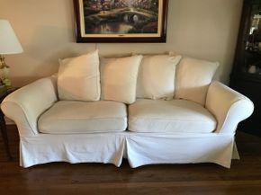 Lot 028 Crate and Barrel Slipcovered Sofa. Approx 28H X 39W X 90L. PICK UP IN HUNTINGTON