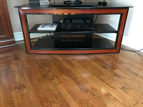 Lot 043 Bello Glass And Wood TV Stand. 24H X 17.75W X 52L. PICK UP IN HUNTINGTON.