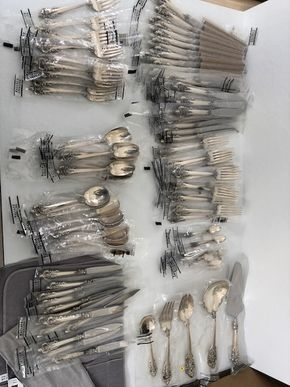 Lot 136 Wallace Grand Baroque Sterling Silver Flatware 112 Pieces Including Place Settings and Service Pieces In Plastic Wrapping ITEM TO BE PICKED UP IN MANHASSET HHILLS