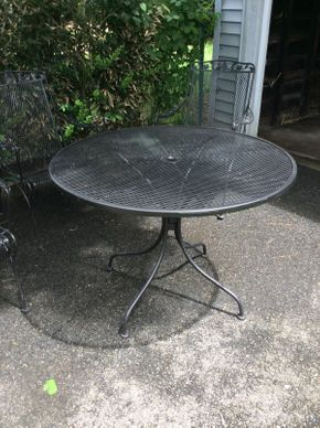 Lot 042 Round Wrought Iron Outdoor Table  ITEM CAN BE PICKED UP IN GARDEN CITY