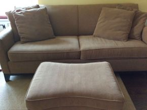 Lot 006 Rowe Upholstered Sofa and Ottoman Sofa 80L x 35D x 33.5h and Ottoman 31L x 17h some stains