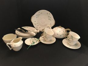 Lot 055 Belleek Luncheon Set with 4 Dishes, Teapot, Cups and Sauces