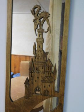 Lot 006 Custom Designed Smokey Mirror with Dragon/Castle Wood Overlay 26 3/4 x 9w ITEMS CAN BE PICKED UP IN GARDEN CITY
