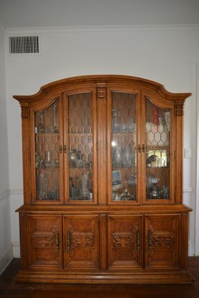 Lot 025 Wood China Cabinet (Contents Not Included) Glass Doors 4 Glass Shelves and 4 Bottom Storage Cabinets 78H x 66W x 17.375L PICK UP IN GARDEN CITY UP IN GARDEN CITY