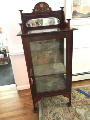Lot 146 Antique Mahogany Curio Cabinet With Key 55.5H x 16.5W x 24L PICK UP IN GARDEN  CITY