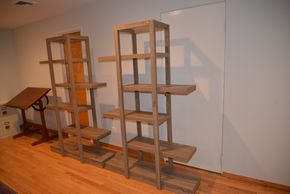 Lot 019 PAIR OF PRESSED BOARD SHELVING 71H X 12L X 46W PICK UP IN PORT WASHINGTON