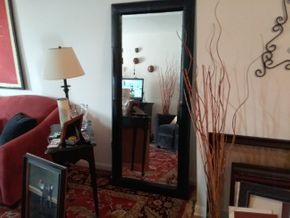 Lot 009 Leather Mirror 70.5H X 12W X 31L. PICK UP IN HEMPSTEAD.