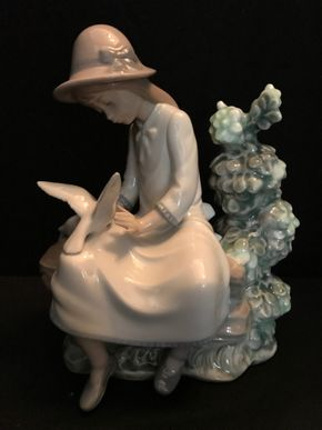 Lot 052 Lladro NAO Feasting Doves Girl On Bench With Doves. 8 In. T X 7 In. L. PICK UP IN BELLMORE.