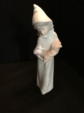 Lot 059 Lladro NAO Peasant Girl Holding Chicken. 7.5 In. T. PICK UP IN BELLMORE.