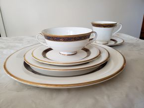 Lot 013 PU Royal Doulton English Fine Bone China Harlow 5034.Five Piece Place Settings. 10-Dinner Plates,Salad Plates,Bread Plates,Cups. Note:7- Saucers. 10-Soup Cups, 1-Tea Cream and Tea Sugar. 1- Covered Vegetable Dish. PICK UP IN GREAT NECK, NY