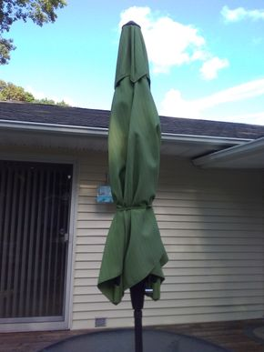 Lot 049 Green 8ft Outdoor Umbrella With Base PICK UP IN COMMACK