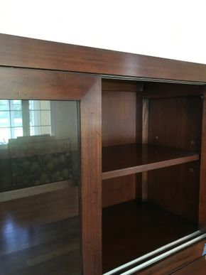 Lot 042 Milling Road Cabinet With Sliding Glass Doors Some Wood Chipping  64.5H x 15W x 54.5L PICK UP IN LAWRENCE