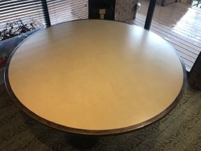 Lot 031 72 INCH round table top, Solidz laminate top, with walnut finished eased edge, and (3) round black metal table bases -small scuffs on table base PICK UP IN ROSLYN