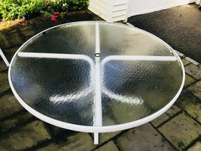 Lot 048 White Glass Round Outdoor Table 27HX60W. CAN BE PICKED UP IN GARDEN CITY.