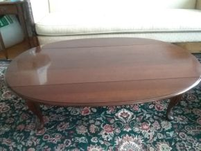 Lot 053 Mahogany Oval Coffee Table With Drop Sides 17H x 19W x 51L closed  PICK UP IN GARDEN CITY