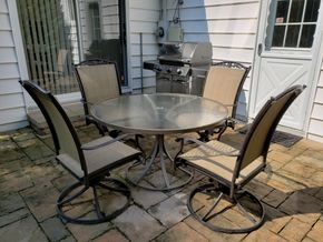 Lot 023 CC-Picked Up on 8-17-2019 Outdoor Dining Set Metal/Glass Round Table w/Swivel Chairs 40H x 19.5W x 21D PICK UP IN ROCKVILLE CENTRE, NY