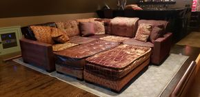 Lot 004 Custom Sectional Couch w/4 interlocking pieces w/hidden casters. Two ottomans fit flush. Various Coordinating Fabrics 144W x 35H x 64D PICK UP IN NEW HAVEN,CT