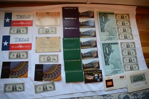 Lot 015 Lot of 14 Proof Sets 1985, 1986, 1987, 1995,1996, 1997 and 2 Dollar Bill, Series 2003A 4 Sub $1 Sheets x2, Christmas 1985 Gold Stamp Replica, $1 Lone Star Note x2, US Currency Star Note $5 x2, Lucky 7 notes x2