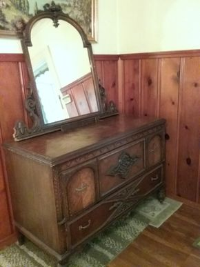 Lot 009 Antique Hand Carved Dresser With Mirror Needs Some Repair AS IS some stains and Chipping 36H x 25W x 54L Mirror is 42 Inches Tall  PICK UP IN WESTBURY