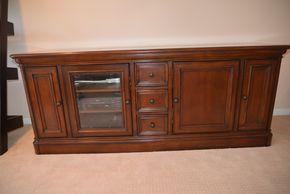 Lot 009 Wood 4 Door Entertainment Console 29.5H x 75W x 21.75L PICK UP IN GLEN COVE, NY