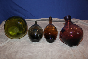 Lot 006 Lot of 4 colored glass vases Tallest is 12 inches H ITEMS CAN BE PICKED  UP IN WESTBURY