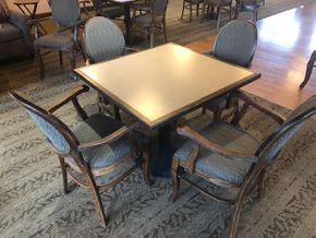 Lot 032 -36 INCH square table top, Solidz laminate top, with walnut finished eased edge and a round black table base -(4) wood arm chairs in walnut finish - fabric on chairs �?? Angelica in Cafe Brown -one chair has a fabric stain PICK UP IN ROSLYN
